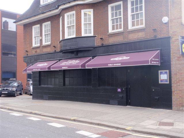 New Gentlemen's Club 'Secrets' with Fixed Triangular Awnings