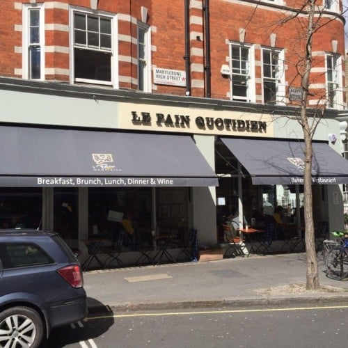 Restaurant awning used on Le Pain Quotidien bakery-restaurant