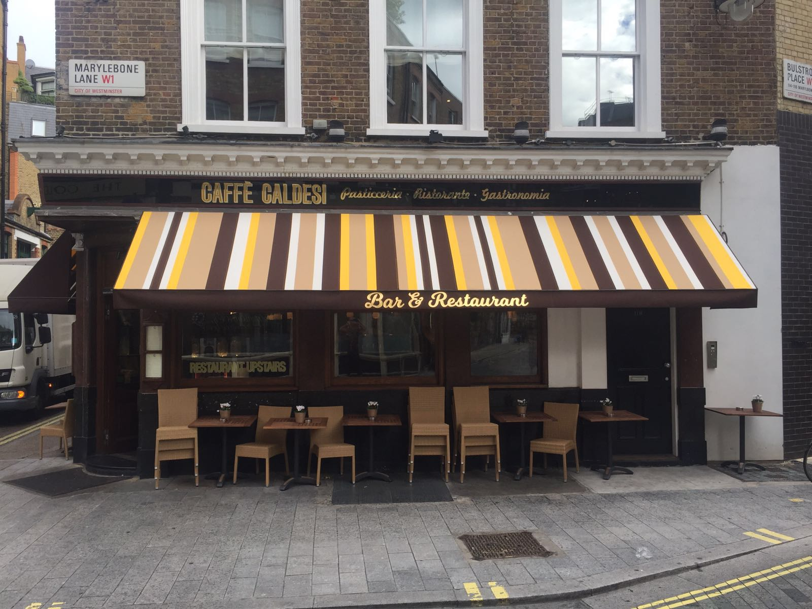 Bespoke Stripe On A Fixed Frame Awning For London