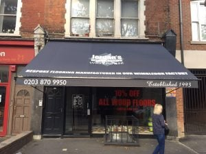 Jordan's Woodflooring, Wandsworth Bridge Road Recover client's existing awning with logo and signwriting